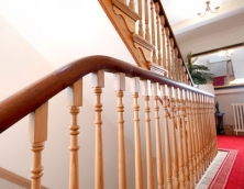 Polished handrail on a bespoke staircase